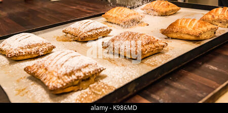 Pastries being made in a Sydney, Australia bakery early in the morning for sale that day - Stock Photo