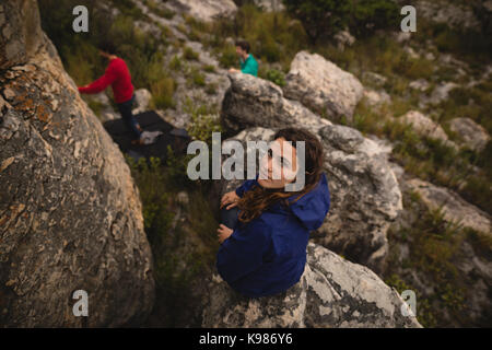 Portrait of confident woman standing on cliff - Stock Photo