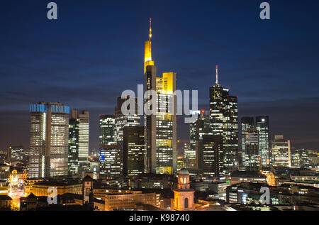 The skyline of the financial district of Frankfurt in the evening - Stock Photo