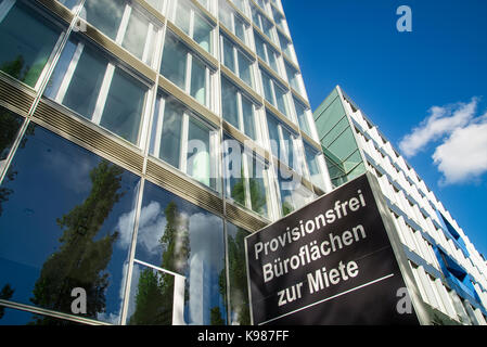 Office building in Frankfurt with sign of a real estate broker - Stock Photo