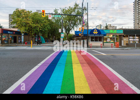 Vancouver, British Columbia, Canada - 13 September 2017: Gay pride flag crosswalk in Vancouver gay village - Stock Photo