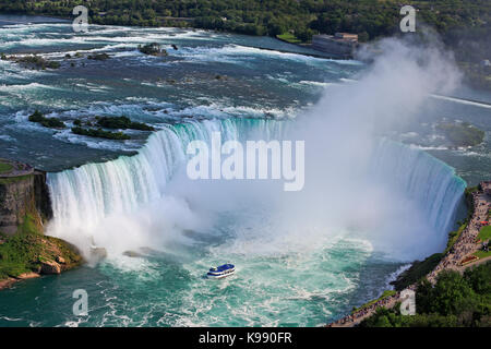 Horseshoe Falls in Niagara and Maid of the Mist boat, aerial view - Stock Photo