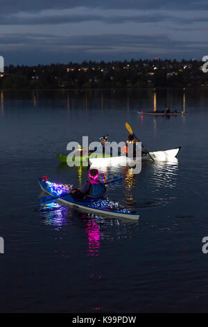 Seattle, Washington, USA. 21st Sep, 2017. A group with illuminated kayaks gather at the Aqua Theater for the Luminata - Stock Photo