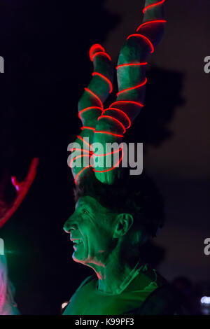 Seattle, Washington, USA. 21st Sep, 2017. Performer in costume with large horns arrives at the terminus of the Luminata - Stock Photo