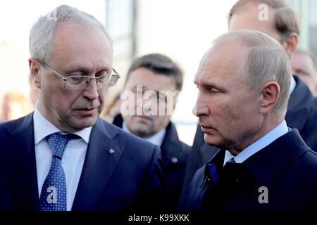 Ulyanovsk, Russia. 22nd Sep, 2017. Russia's President Vladimir Putin (R) attends an exhibition on public transportation - Stock Photo