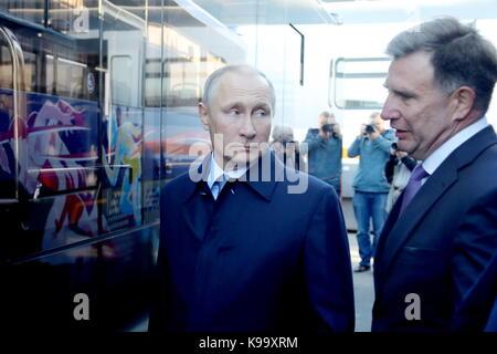 Ulyanovsk, Russia. 22nd Sep, 2017. Russia's President Vladimir Putin (L) attends an exhibition on public transportation - Stock Photo