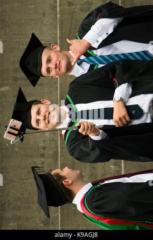 Higher Education in the UK: Aberystwyth University students taking a selfie photograph  wearing traditional academic - Stock Photo