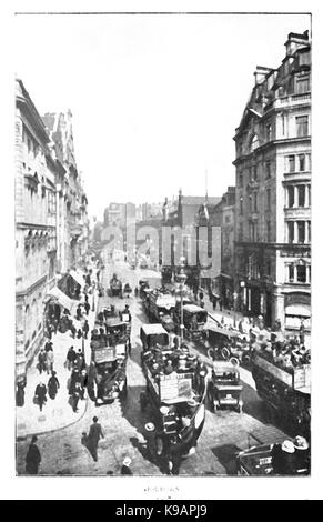 A view of horse-drawn and motor traffic in old Holborn London - Stock Photo
