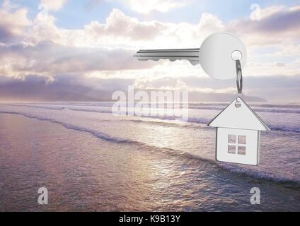 Digital composite of 3D House key floating over sea - Stock Photo