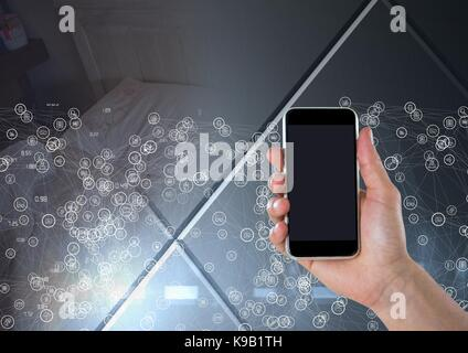 Digital composite of Hand holding phone with connectors over transition - Stock Photo