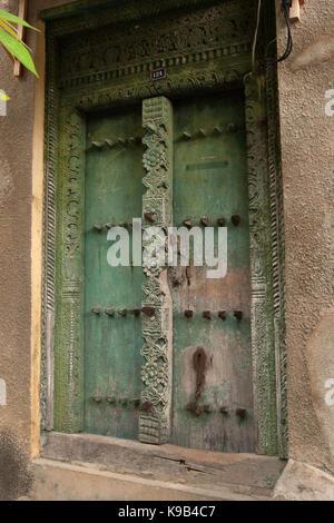 Ornate Swahili door in Stone Town, Zanzibar, Tanzania, East Africa - Stock Photo