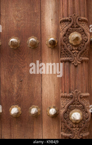 Detail on an ornate carved wooden door, Stone Town, Zanzibar, Tanzania, East Africa - Stock Photo