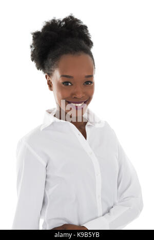 Portrait of happy young hostess standing against white background - Stock Photo