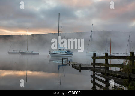 Boats on Coniston Water Cumbria Lake District - Stock Photo