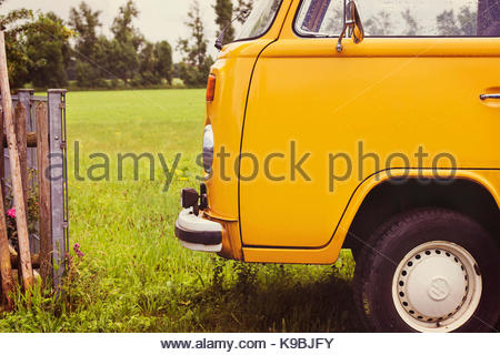 Yellow classic Volkswagen camper van - Stock Photo
