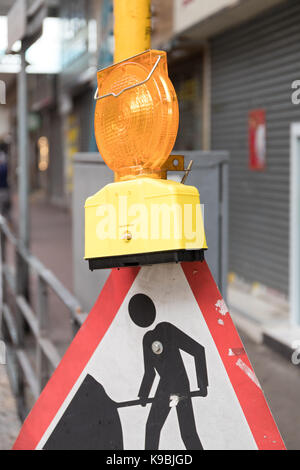 Road Works Sign With Light at Street - Stock Photo