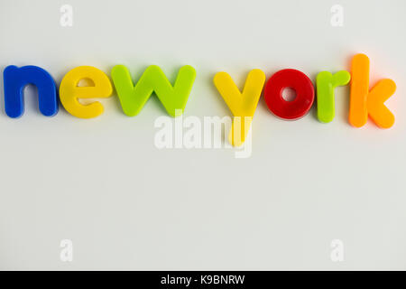 Word new york in orange in 3d on white background stock photo new york words in colourful childrens letters stock photo publicscrutiny Choice Image