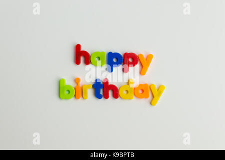 happy birthday words in colourful children's letters - Stock Photo