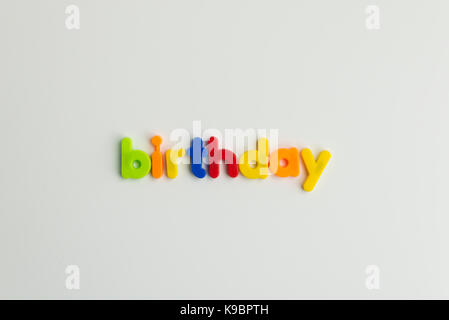 birthday word in colourful children's letters - Stock Photo