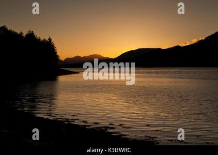 Sunset behind the hills and mountains of North Ballachulish, Glencoe, Scotland, UK - Stock Photo