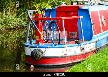 A bike or bicycle on a canal boat or narrowboat on the Staffordshire and Worcestershire Canal near to Tixall, Stafford, - Stock Photo