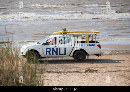 RNLI lifeguard on patrol Crosby beach part of the crosby coastal park liverpool - Stock Photo