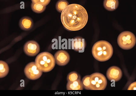 Garland of bulb lamps with modern yellow LED lighting elements, close up photo with selective focus and real photo - Stock Photo