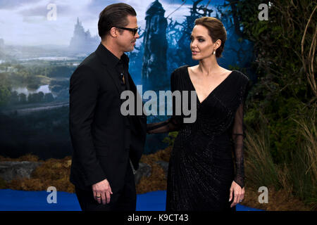 Angelina Jolie and Brad Pitt arrive for the premiere of 'Maleficent' in London on 08.05.2014. - Stock Photo
