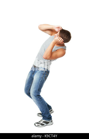 Young man defending himself from something on top isolated on white background - Stock Photo