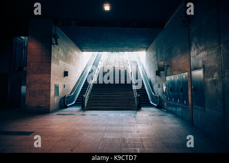Exit with escalator from the underground metro. Light at the end of the tunnel concept - Stock Photo