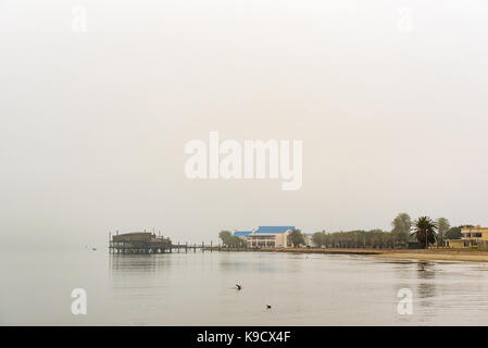 WALVIS BAY, NAMIBIA - JULY 1, 2017: The Raft Restaurant and a hotel at the lagoon in Walvis Bay on the Atlantic - Stock Photo
