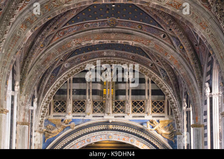 Italy, Siena - December 26 2016: close up view of Metropolitan Cathedral of Santa Maria Assunta interior. Nave of - Stock Photo