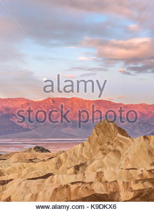 Manley Beacon at Dawn with Moon setting over the Panamint Mountains, Death Valley National Park, California - Stock Photo