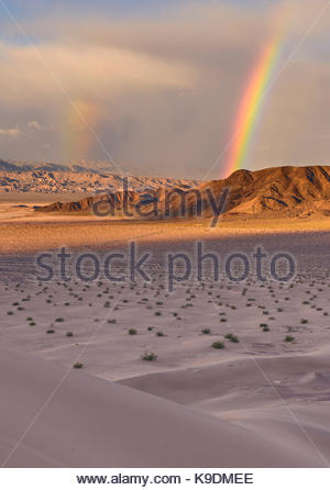 Double Rainbow over Saratoga Spring from Ibex Dunes, Death Valley National Park, California - Stock Photo