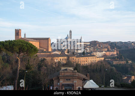 Italy, Siena - December 26 2016: the view of the Duomo di Siena from Medici Fortress on December 26 2016 in Siena, - Stock Photo