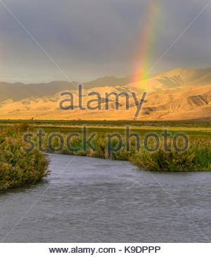 Rainbow over the Stillwater Range and Marsh at Sunset, Stillwater National Wildlife Refuge, Nevada - Stock Photo