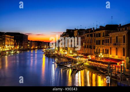 Twilight scene from the Rialto Bridge in Venice, Italy - Stock Photo
