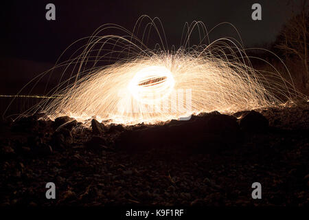 Fire ball. Light painting with steel wool spinning - Stock Photo