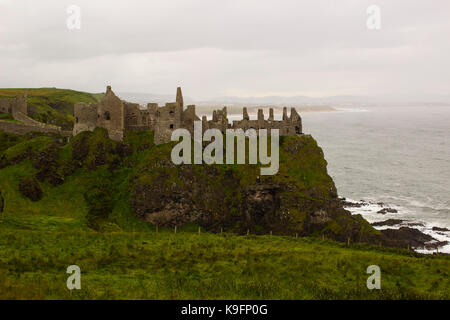 The historic Dunluce Castle ruins near Bushmills on the North Antrim coast in Northern Ireland often used as a film - Stock Photo