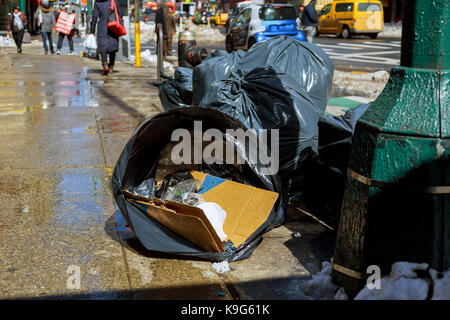 snow in the winter on the road in New York City Snow blizzard weather in Manhattan Times Square - Stock Photo