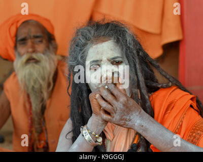 Middle-aged Indian Hindu holy woman (sadhvi, female sadhu) with dreadlocks and vibhuti (white sacred ash) on her - Stock Photo