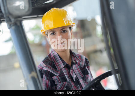 Forklift Truck Operating by Caucasian Factory Worker in His 30s