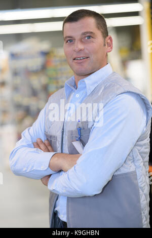 handsome hardware store salesman - Stock Photo