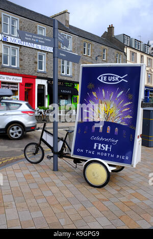 Fish bar advert on a bicycles in Oban - Scotland UK - Stock Photo