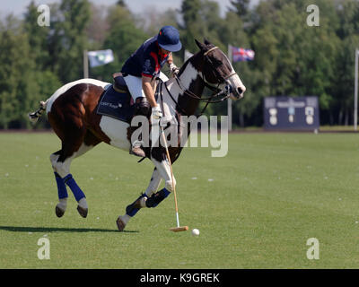 Tseleevo, Moscow region, Russia - July 26, 2014: Unidentified player of British schools with mallet in the match - Stock Photo