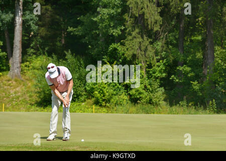 Tseleevo, Moscow region, Russia - July 24, 2014: Unidentified golfer on the golf course in the Tseleevo Golf & Polo - Stock Photo