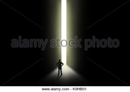 Light In Dark Room silhouette of a male entering a dark room with a shaft of light