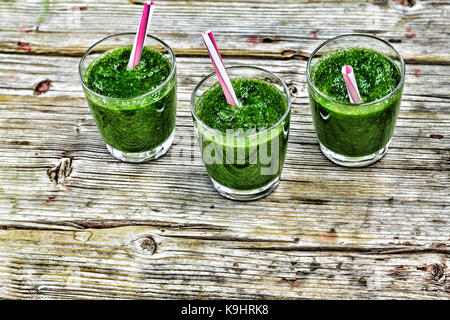 Detox drink from spinach and various green vegetables wooden background - Stock Photo