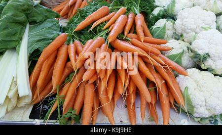 A variety of fresh carrots for sale at a local market. Marché Saint-Antoine Célestins