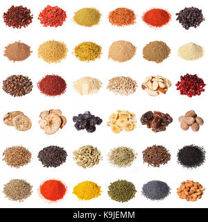 Large collection of different spices, herbs, nuts, dried fruits, beans, berries isolated on white background. - Stock Photo